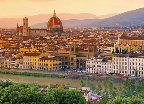 Aerial view of Florence, including Florence Cathedral and the Basilica of Santa Croce from across the Arno River in Italy